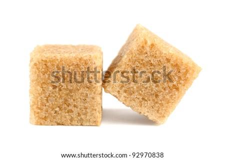 Cubes of cane sugar isolated on white background - stock photo