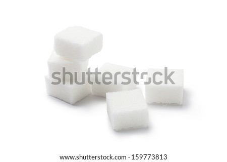 Cubes of sugar on white background - stock photo