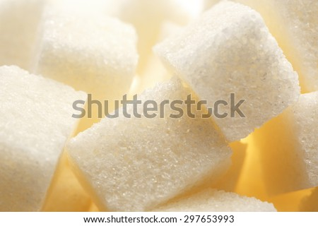 Cubes of white sugar in closeup background - stock photo
