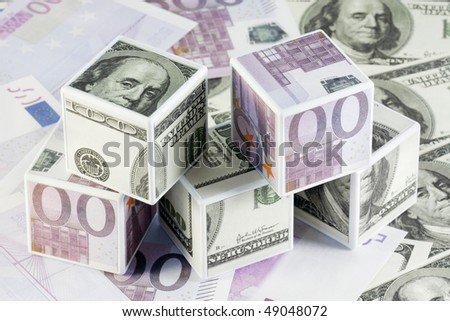 cubes pasted over with dollars and euros - stock photo