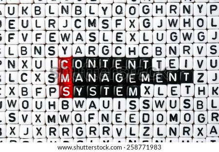 cubes with text CMS ,Content Management System - stock photo
