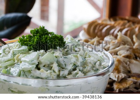 Cucumber salad with dill and sour cream - stock photo