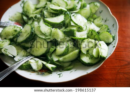 Cucumber salad with fresh dill - stock photo