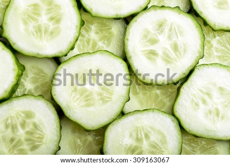 Cucumber slices as a background - stock photo