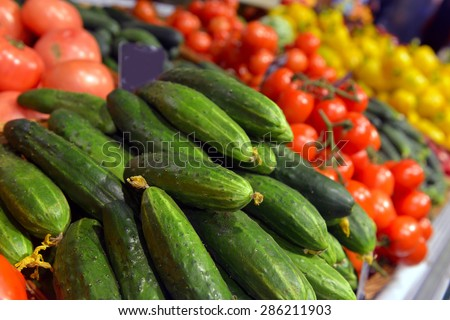 Cucumbers on display in a supermarket - stock photo