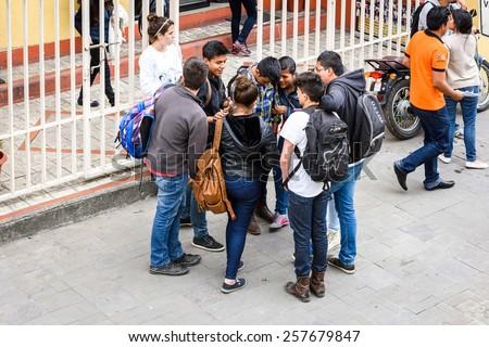 CUENCA, ECUADOR - JAN 9, 2015: Unidentified Ecuadorian people in the street. 71,9% of Ecuadorian people belong to the Mestizo ethnic group - stock photo