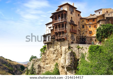 "CUENCA, SPAIN - JUNE 10, 2014: Casas colgadas ""hanging houses"". Many casas colgadas are built right up to the cliff edge,making Cuenca one of the most striking towns in Spain                           - stock photo"