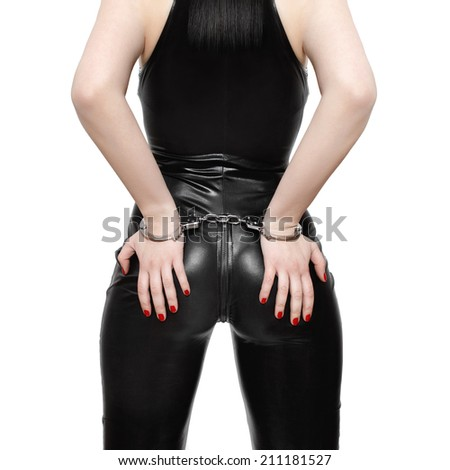 Cuffed woman closeup, isolated on white background - stock photo