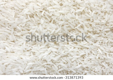 Cuisine and Food, Background of Uncooked White Long Rice, Basmati Rice or Jasmine Rice. - stock photo