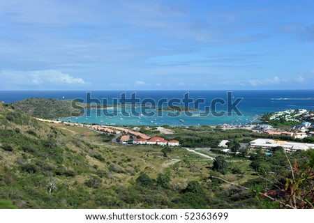 Cul de sac bay, St Martin French side, West Indies. From the beach, shuttle boats make the five-minute trip to Islet Pinel - stock photo