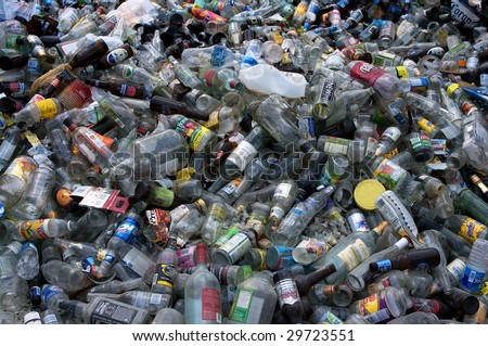 CULPEPER, VA - CIRCA 2008: Glass and plastic bottles lie in a heap at an undisclosed recycling facility circa 2008 in Culpeper. The glass and plastic will be sorted for recycling. - stock photo