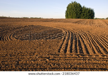 cultivated farm field agriculture landscape. Earth soil texture - stock photo