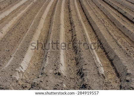 cultivated soil/fresh forrow/plough in - stock photo
