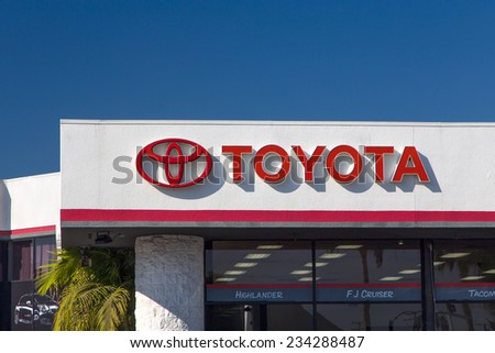 CULVER CITY, CA/USA - NOVEMBER 29, 2014: Toyota automobile dealership sign. Toyota is a multi-national Japanese automotive manufacturer. - stock photo