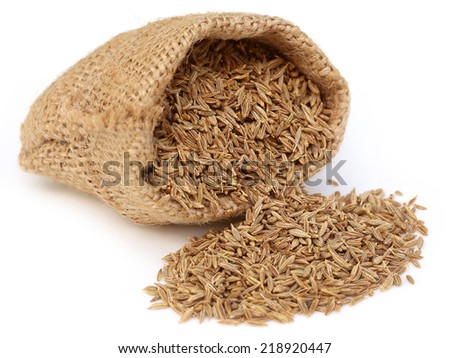 Cumin in sack bag over white background - stock photo