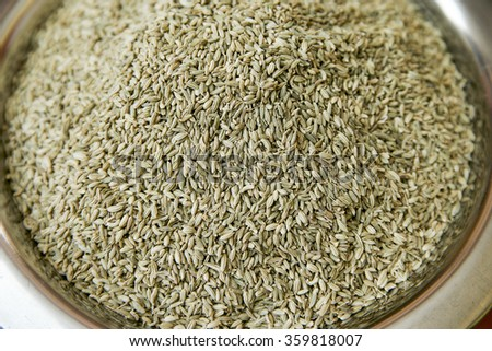 Cumin seeds selling in spice market. Focus pointed at the center and shallow DOF. - stock photo