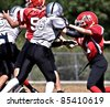 CUMMING, GA - SEPT. 24 : 11 to 13-year-old unidentified boys running and blocking during a football game, the Raiders vs the Red Devils, on August 27, 2011 in Cumming GA. - stock photo