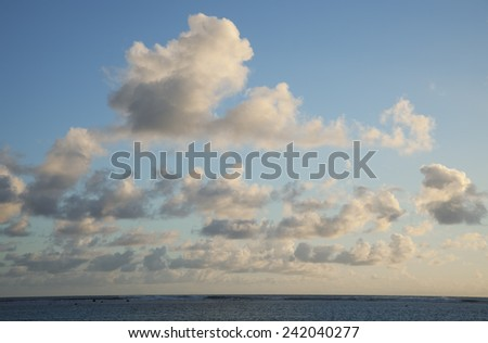 Cumulus Clouds above South Pacific Ocean at Sunset - Rarotonga, Cook Islands, Polynesia - stock photo