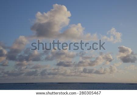 Cumulus Clouds above South Pacific Ocean at Sunset - Rarotonga, Cook Islands, Polynesia - stock photo