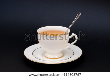 Cup and spoon - stock photo