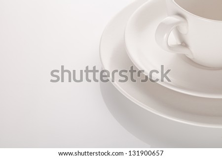 cup and two saucer over white background - stock photo