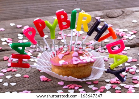 Cup cake with candle Happy Birthday - stock photo
