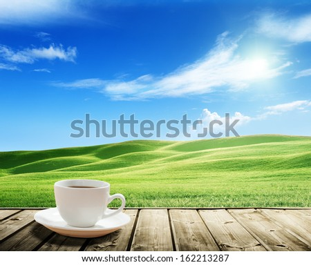 cup coffee and tuscany hills, Italy - stock photo