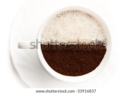 Cup full of ground coffee and white sugar is isolated over a white background - stock photo