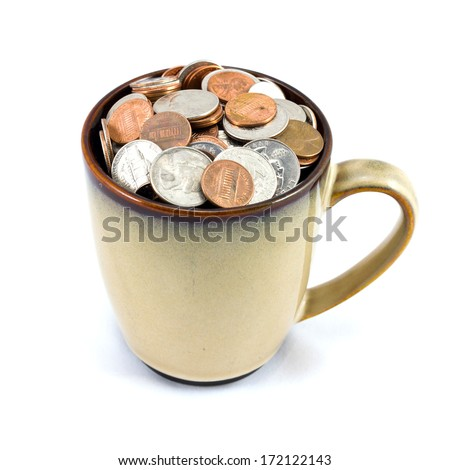 Cup full of US coins isolated on white background - stock photo