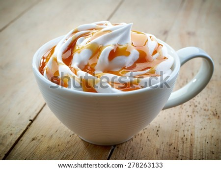 cup of a fresh caramel latte with whipped cream - stock photo