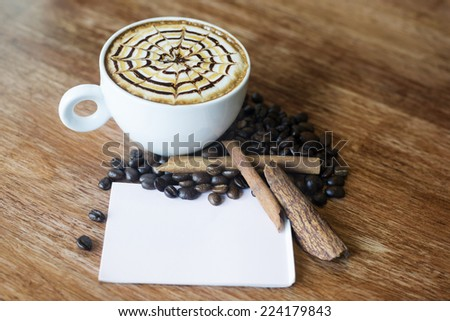 Cup of art latte ,note paper - stock photo