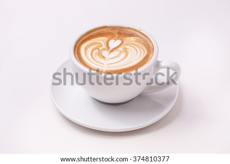 Cup of art latte on a cappuccino coffee isolated on white background - stock photo