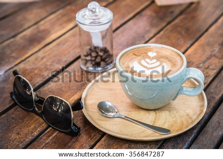 Cup of art latte or mocha coffee - stock photo
