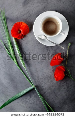 Cup of black coffee, espresso set with wild flowers - poppies, on grey grunge background. - stock photo