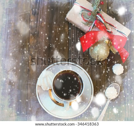cup of black coffee, meringue and New Year gift - stock photo