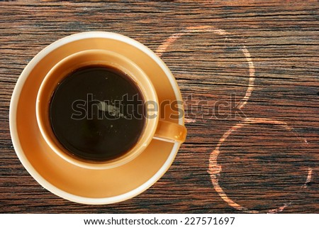 cup of black coffee on grunge wood background - stock photo