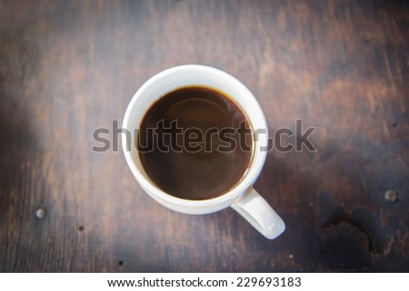 cup of black coffee over grunge wood - stock photo