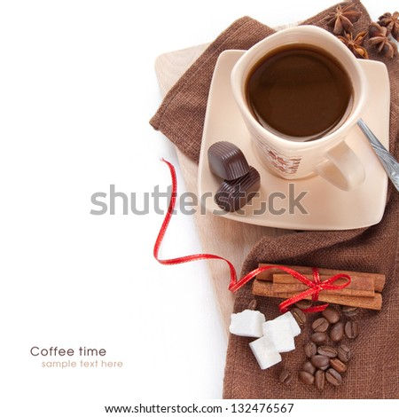Cup of black coffee with cinnamon, candy and sugar on the white background - stock photo