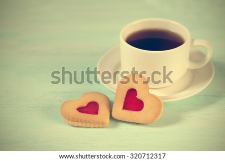 Cup of black tea and heart shaped cookies, for valentine's day  - stock photo