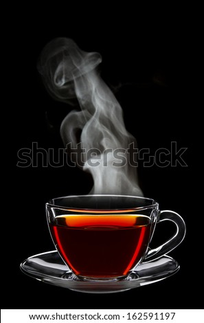 Cup of black tea isolated on black background - stock photo