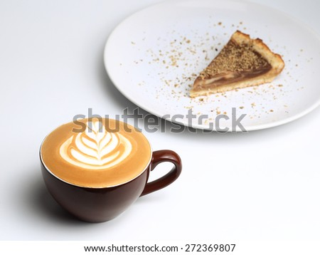 Cup of cappuccino and a piece of cake. Latte art. Isolated on white background - stock photo