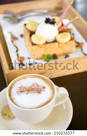 Cup of Cappuccino Coffee and Honey Toast Ice Cream  in background - stock photo
