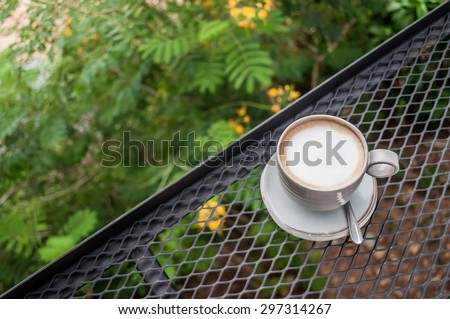 Cup of Cappuccino Coffee on cage with natural - stock photo
