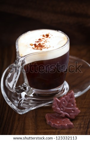 Cup of Cappuccino coffee with chocolate - stock photo
