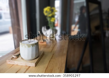 Cup of Cappuccino in cafe. - stock photo