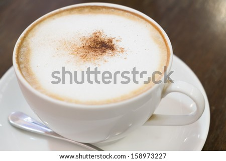 Cup of cappuccino in white cup - stock photo