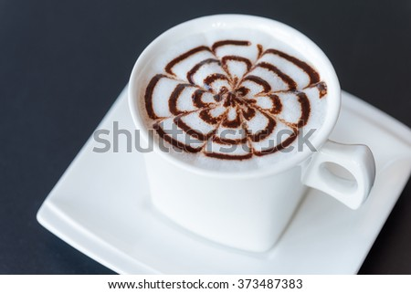 Cup of cappuccino on table - stock photo