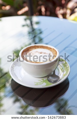 cup of cappuccino over wooden table. - stock photo