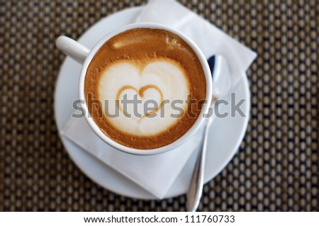 Cup of cappuccino with heart - stock photo