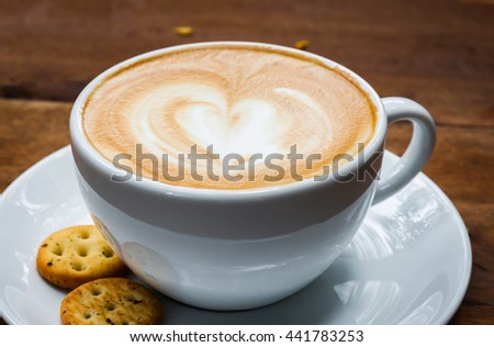 cup of cappucino and biscuits on a wood background - stock photo